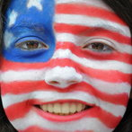 A woman with a US flag painted on her fa