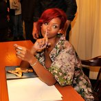 "Rihanna Signs Her Book ""Rihanna: The Last Girl On Earth"""