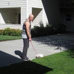 Shawn tries to walk the cat.
