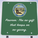 Parks and Recreation - Town Slogan - Pawnee: The re-gift that keeps on re-giving.