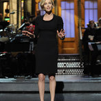 Charlize Theron hosts Saturday Night Live with musical guest The Black Keys on May 10, 2014.