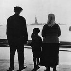 Family Views Statue Of Liberty From Ellis Island