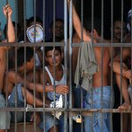 Convicts remain inside a cell of the loc