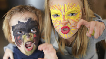 Kids with face paint, playing