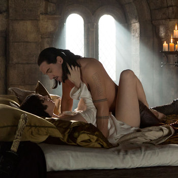 Dracula - Ilona embaces a scantilly clad Vlad Tepes in bed chambers